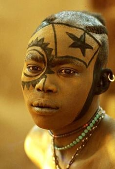 Africa | The painted face masks of the Kau Nabu | © Leni Riefenstahl.
