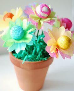 flower bouquets with cake balls.  Would be so cute with yellow centers and coffee filter petals.