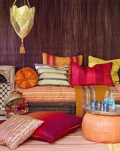 Indian meets Morroccan in this colorful and comfortable looking living room.