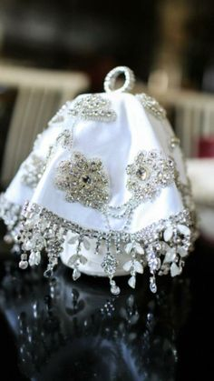 Mindila, a handkerchief worn in Turkey, Albania, Kosova, and allover the Balkans by brides and other women at weddings and other parties. It's usually the most decorated for the brides.