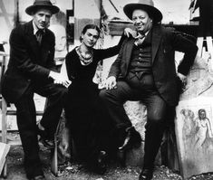 This is sculptor Ralph Stackpole with Diego and Frida. The photo was taken in 1931 in Ralph's sculpture yard behind his studio at 716 Montgomery, SF, CA where the Rivera's were staying during their first visit to the US. www.riveramural.org