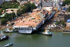 INS Vikrant, India's first indigenously built aircraft carrier, moves out of dry dock for further outfitting [1200x800]
