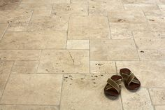 eco outdoor Capri tumbled unfilled travertine tiles laid in French pattern -