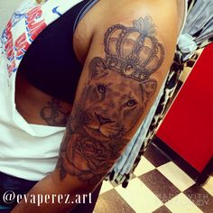 Lioness tattoo with crown and rose @evaperez.art