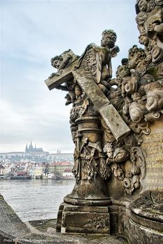 Detail of the statue - The sign of the Cross, Charles Bridge Prague. Czech Republic.