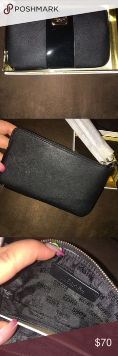 "Michael Kors Met Center Stripe LGTZ Wristlet Black New with out tags never been used in perfect condition no flaws no damage comes with box Zip around closure   Detachable wrist strap  Gold- tone hardware  Leather interior & MK sig lining  Open compartments  2 Bill compartments  3 slip pockets  zip coin pocket  16 credit card slots  ID Window    Approx measurements:  8.25""(L) x 4""(H) x .75""(D) Michael Kors Bags Clutches & Wristlets"