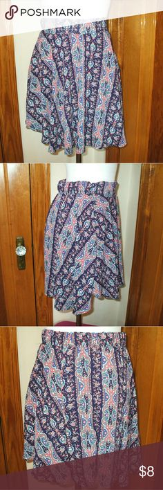 Asymmetrical Paisley Skirt Partially elastic waist - Asymmetrical bottom hem - Navy blue base with pink, white, blue, & turquoise in a paisley print - Lined - New with store tags - smoking home Charlotte Russe Skirts Asymmetrical