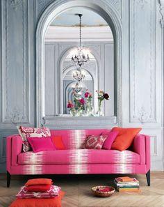 Crown molding, herringbone floor and a pink sofa!