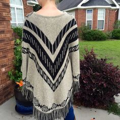 NO REGRETS!!! Aztec Navaho Poncho Shawl, NWOT CHARMING CHARLIE Southwestern Aztec Navaho print knitted Poncho / Shawl (with sleeves). One size! Acrylic, Nylon, Polyester. Charming Charlie Accessories Scarves & Wraps
