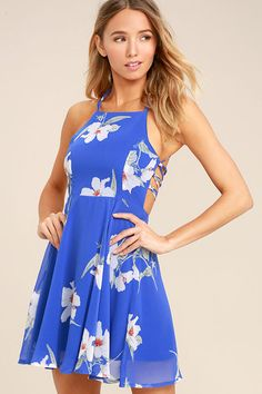 Lulus Exclusive! Every happy ending begins with the Happy Together Royal Blue Floral Print Lace-Up Dress! Grey, green, and orange floral print decorates royal blue woven poly as it sweeps across an apron neckline, princess-seamed bodice, and a lace-up, open back. Full skater skirt has a bit of elastic at back. Hidden back zipper.