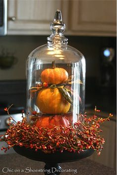 Fall centerpiece created from disassembled old pumpkin decorations. Chic on a Shoestring Decorating.blogspot