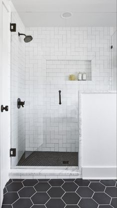 Like the shower tile and layout with glass door in inset. Best Bathrooms by Joanna Gaines; Fixer upper's top bathroom renovations by Joanna and chip Gaines! These rustic, country with hints of modern perfection bathrooms are everythin White Subway Tile Bathroom, Subway Tile Showers, White Tile Bathrooms, White Tile Shower, Tiled Showers, Master Bathroom Shower, Diy Bathroom, Bathroom Ideas, Bathroom Interior