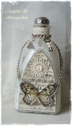 heart bottle sponge paint white and heart shaped music notes decoupage, string of pearls plack lace around top Altered Bottles, Antique Bottles, Recycled Bottles, Vintage Bottles, Bottles And Jars, Glass Bottles, Mason Jars, Perfume Bottles, Bottle Lamps