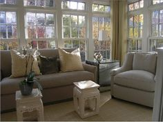 gray & yellow elegant living room design with gray upholstered furniture and pretty pops of yellow gold are gorgeous! Love the little Asian cream zen ceramic garden stools