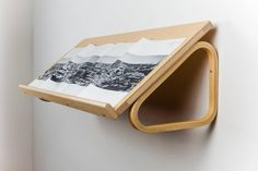 Alvar Aalto Magazine Shelf for Artek, Blond Wood, Finland 1950s | From a unique collection of antique and modern shelves at https://www.1stdibs.com/furniture/storage-case-pieces/shelves/