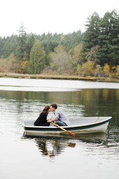 A rustic chic engagement shoot in Gig Harbour, WA. The couple frolic in wheat fields, row in a boat and kiss in a barn. Photos by Lola and Bliss Photography