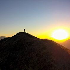 natgeo  . Photo by @salvarezphoto  Pedro Perucho on the rim of Paritucin Volcano at dawn.