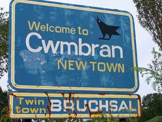 "Cwmbran (kum-brawn), Wales. The name is from ""Cwm Brân"", meaning ""valley of the river Brân."" ""Brân"" means ""crow"", which could allude to the dark waters of the river, or may have been the name of a person."