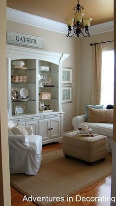 The rug & neutrals with white and the pretty open cabinet.