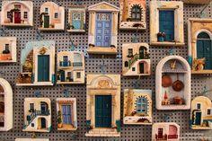 Beautiful Santorini doors in a souvenir shop in Fira Clay Houses, Ceramic Houses, Miniature Rooms, Miniature Houses, Miniature Furniture, Doll House Plans, Greek House, Fairy Doors, Fairy Houses