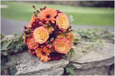 Fall bridal bouquet:roses and Gerbera daisies in shades of red and orange. Evergreen Country Club in Haymarket, Virginia. Image by Photography Du Jour