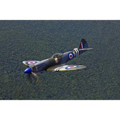 A Supermarine Spitfire Mk-18 in flight Canvas Art - Scott GermainStocktrek Images (35 x 23)