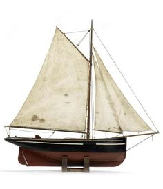 A Cutter rigged pond yacht,