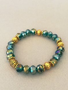 This green gold bracelet is made with green round crystals and gold beads Measure: 7 inch