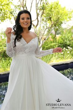 Off shoulder lace sleeves, chiffone skirt in this on of a kind plus size wedding gown!