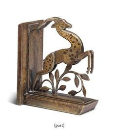 A PAIR OF FRENCH WROUGHT-IRON BOOK ENDS CIRCA 1925, IN THE MANNER OF MICHEL ZADOUNAISKY