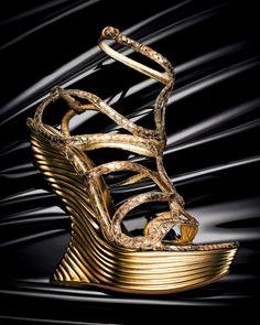 Alexander McQueen python platform wedge sandal.