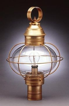 Caged Onion Post Dark Antique Brass Medium Base Socket Clear Seedy Glass by Northeast Lantern. $484.00. Post lantern with onion glass and cage. Available in a variety of finishes and two glass options. Handcrafted in New Hampshire. Made of solid brass and copper with hand applied finishes. With the exception of glass, product is guaranteed for life.Note: Pier mount and post must be ordered separately. . Verdi Gris fixtures are NOT returnable.