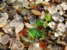 Glass Beach is a beach park in MacKerricher, near Fort Bragg, California, USA. What draws attention is the sand on this beach with multi colored glass pebbles. The beach park is a preserved, often visited by tourists. The pebbles can't be removed.  02