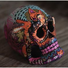 A unique laughing soul. Hand painted, one of a kind paper mache Dia de los Muertos style skull. Signed and dated by artist. Measures roughly 4 inches high, 5 inches deep.   Following proper tradition, this skull can be personalized. Email dedication requests/details to laughingsoulsbk@gmail.com