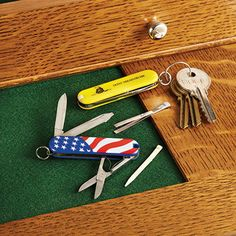 """Patriotic Knives put quality in your hand There's nothing neutral about these Swiss Army pocket knives.Available in American Flag or Gadsden """"Don't Tread On Me"""" Flag."""