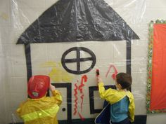 """Use a clear shower curtain to paint on. We taped a house outline to the backside, and let the kids paint """"fire"""" onto the house, then used squirt bottles to """"hose"""" it off during our Firefighters Week! Kept the kiddos busy for a while!"""