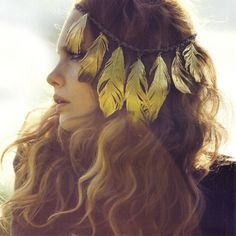 golden feathers in her hair