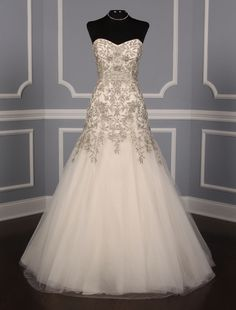 Kenneth Pool Cassandra K449 wedding dress at up to 90% off retail. The workmanship on this gown is out of this world! Its fit and flare silhouette