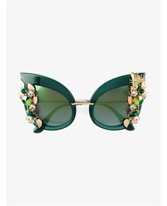 Green acetate and Swarovski crystal embellished sunglasses from Dolce & Gabbana featuring cat eye frames, tinted lenses, a logo at the temple, crystal embellis… Sunglasses For Your Face Shape, Clear Sunglasses, Cat Eye Sunglasses, Sunglasses Sale, Crazy Sunglasses, Luxury Sunglasses, Stylish Sunglasses, Bee Glasses, Funky Glasses