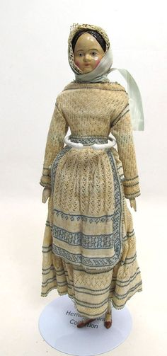 In this auction, we have an antique late 1800's, circa 1880, wood, composition, and leather doll measuring at approx.