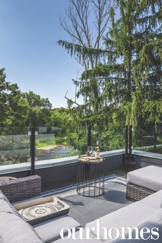 A deck with a view! An outdoor sectional couch and glass railing with views to the trees were great ideas!