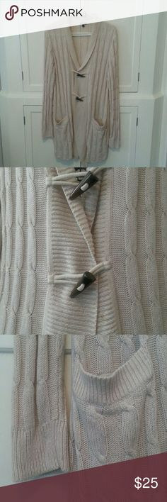 "TALBOTS Long oatmeal color, cable knit cardigan. Heavy weight. Very Minor pilling under arms, can be easily shaved. Beautiful detailed loop closure. Two usable front pockets. See pic 2, there is a small stain. Not noticeable when buttoned.  Pit to pit 20"" Shoulder to hem 33"" GREAT SWEATER! Talbots Sweaters Cardigans"