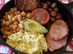 Skillet breakfast - scrambled eggs with chives, peameal bacon, sauteed mushrooms, fried potatoes and toasted homemade baguette.