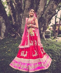 """Bride Karuna is a vision in this red and pink @anushreereddyofficial lehenga -  gorgeously captured by @thephotodiary3.  Photo Courtesy- Monisha Ajgaonkar…"""