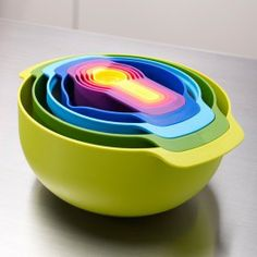 Nest 9 Plus by Joseph Joseph is a nesting set comprised of one large and one small mixing bowls, a colander, a stainless steel mesh sieve and five measuring cups that range from 1 teaspoon (5 ml) to 1 cup (250 ml). $50