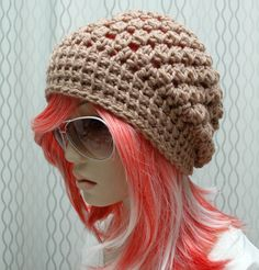 This is kind of what I was thinking of for a slouchy hat. The tightish band, and looser for the rest of it (not so chunky though). I want something long enough to be slouchy, but not hanging off my head all crazy.