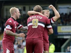 Chris Martin, Jamie Ward and Jonny Russell celebrate The Rams 3-0 away win at Yeovil Town
