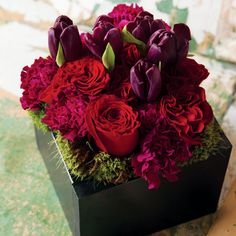 """Evangeline:    Rich jewel toned blooms of amethyst tulips, scented hyacinth and ruby red ruffled roses surrounded by a bed of lush moss create a ravishingly regal splendor.  Gathered in a sleek noir painted hand crafted wood box, Evangeline measures 7"""" x 7"""" x 8"""" and requires next day shipping.    http://www.oliveandcocoa.com/product/Evangeline?r=PT_A_201204"""