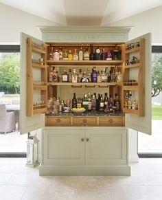 As a gin connoisseur homeowner Stuart indulged his passion with this bespoke drinks cabinet affectionately titled his 'alchemy cupboard' hence the bespoke engraving above the doors. Home Bar Cabinet, Drinks Cabinet, Open Plan Kitchen, New Kitchen, Family Kitchen, Pantry Design, Kitchen Design, Bar Sala, Larder Cupboard