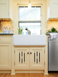 Decorative vent cutouts add detail and allow radiator heat to circulate from under this farmhouse sink. Furniture-like feet add to the period feel. |   Photo: Chad Holder | thisoldhouse.com